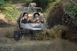 Couples having a great time driving Mud Kart in Extreme Sports Philippines Adventure Park in Puerto Galera.